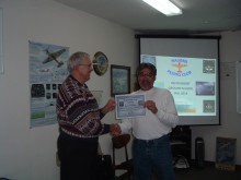 Instructor Dennis Mathis presents Denis Rottler with his EOC certificate.